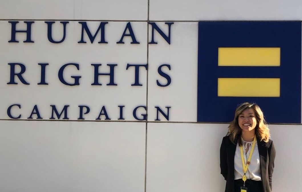 student in front of Human Rights Campaign building